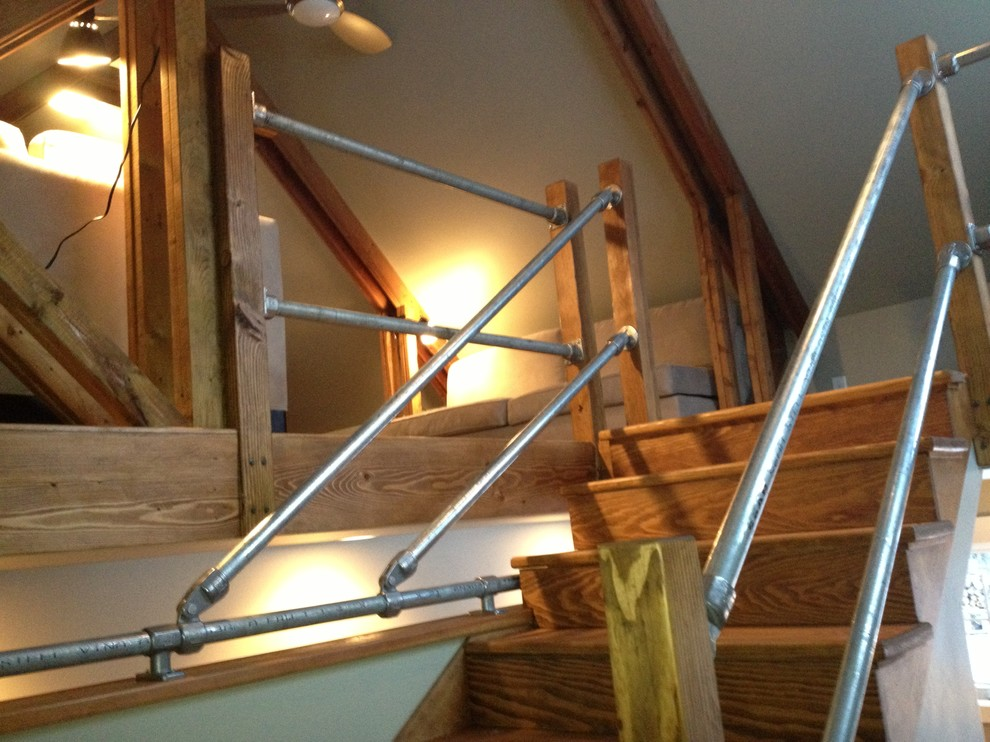 Small urban wooden u-shaped staircase photo in Other with wooden risers