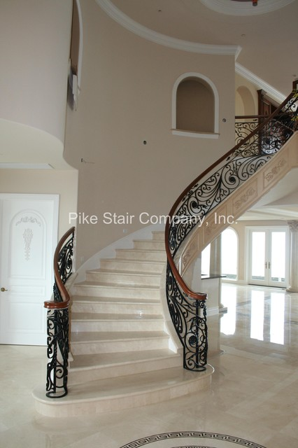 Marble Staircase with Maple Handrail & Iron Panels staircase