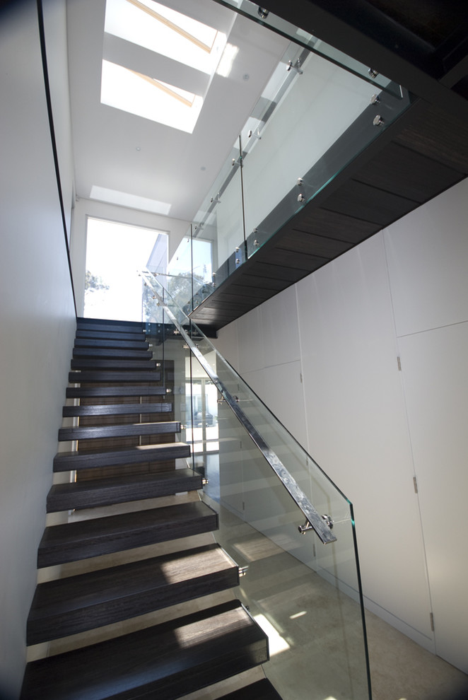 Inspiration for a modern floating open and glass railing staircase remodel in Sydney