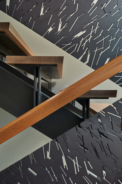 Example of a large trendy wooden u-shaped open staircase design in Seattle
