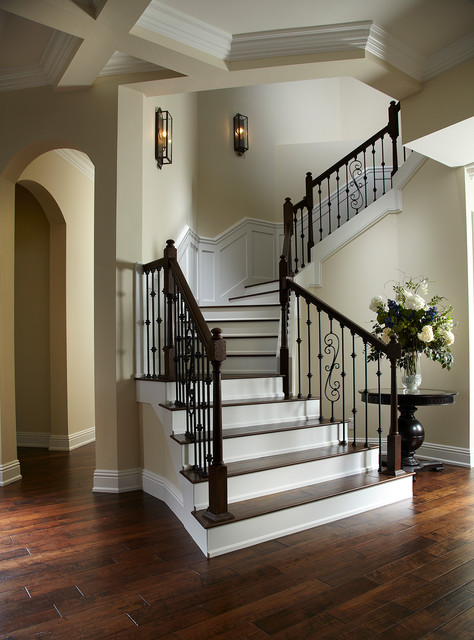 Inspiration for a timeless wooden curved mixed material railing staircase remodel in Tampa with painted risers