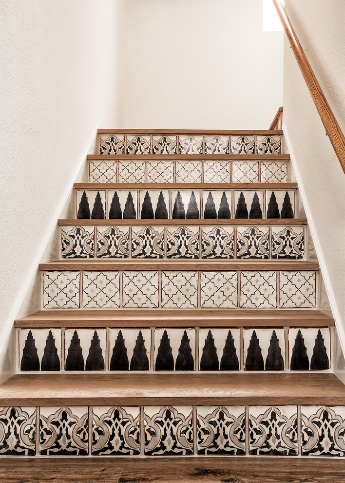 Inspiration for a small contemporary wooden u-shaped staircase remodel in Phoenix with tile risers