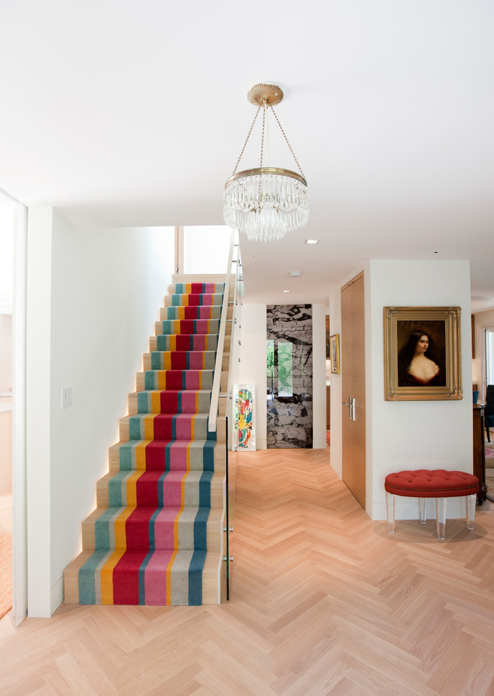 Staircase - eclectic wooden straight glass railing staircase idea in Vancouver with wooden risers