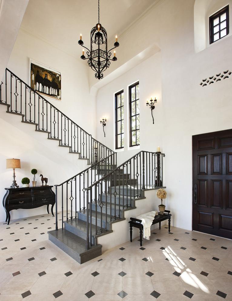 Staircase - mediterranean l-shaped staircase idea in Santa Barbara