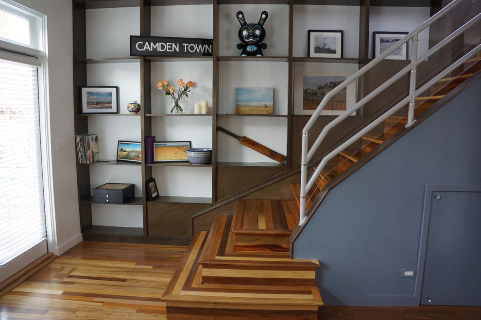 Example of a trendy wooden staircase design in Chicago with wooden risers