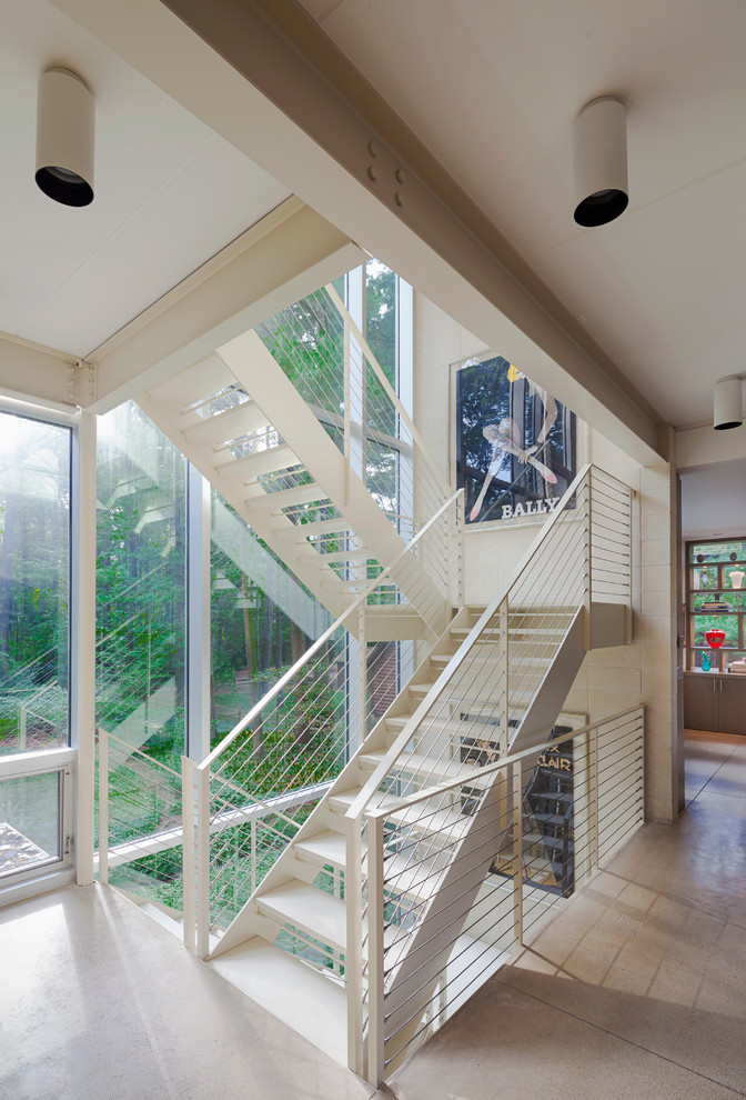 Example of a large minimalist painted floating open staircase design in Grand Rapids