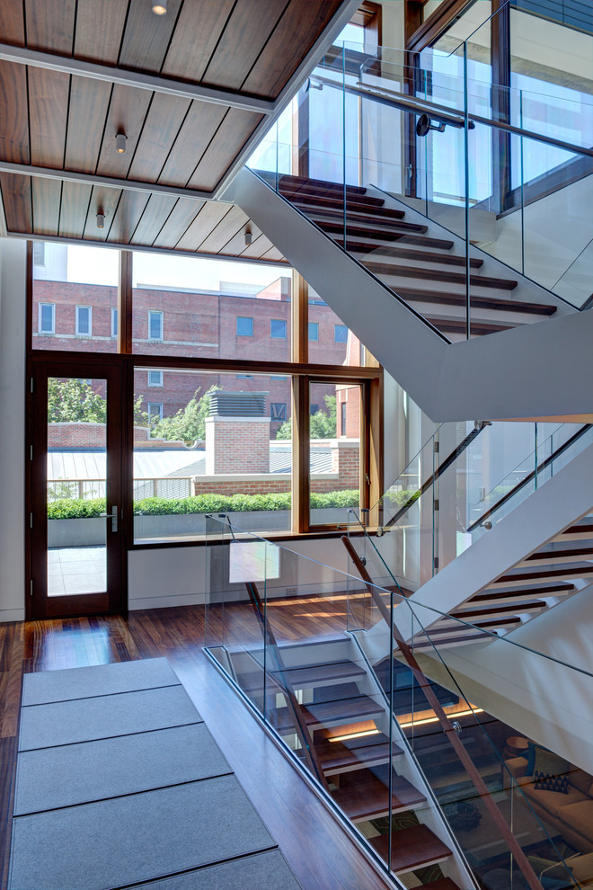 Inspiration for an industrial open and glass railing staircase remodel in Chicago
