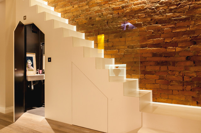 Minimalist Staircase With Hidden Under Stair Cloakroom