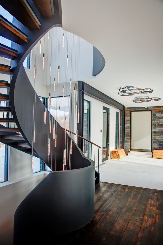 Inspiration for a contemporary wooden curved open staircase remodel in New York