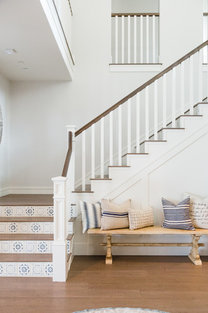 Staircase - beach style wooden l-shaped wood railing staircase idea in San Diego with tile risers