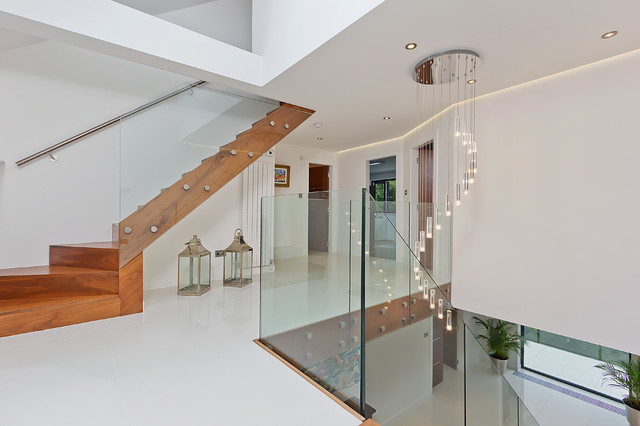 Staircase chandelier houzz staircase contemporary glass railing staircase idea in sussex aloadofball Image collections