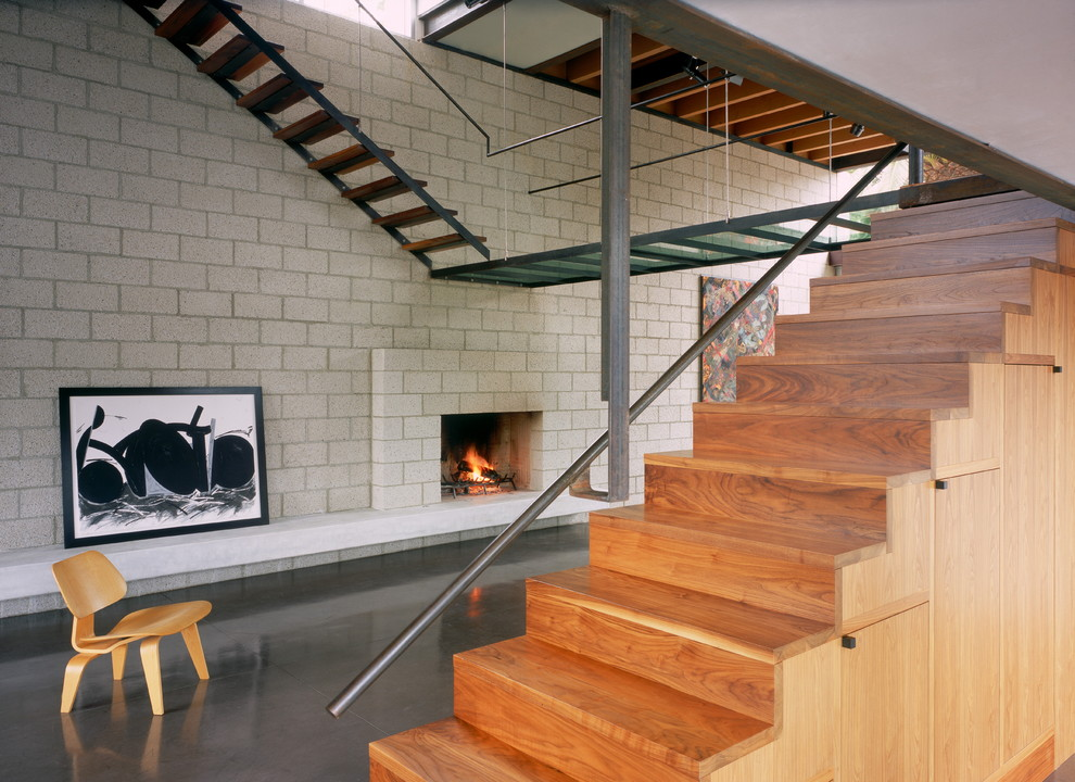 Staircase - industrial wooden staircase idea in Los Angeles with wooden risers