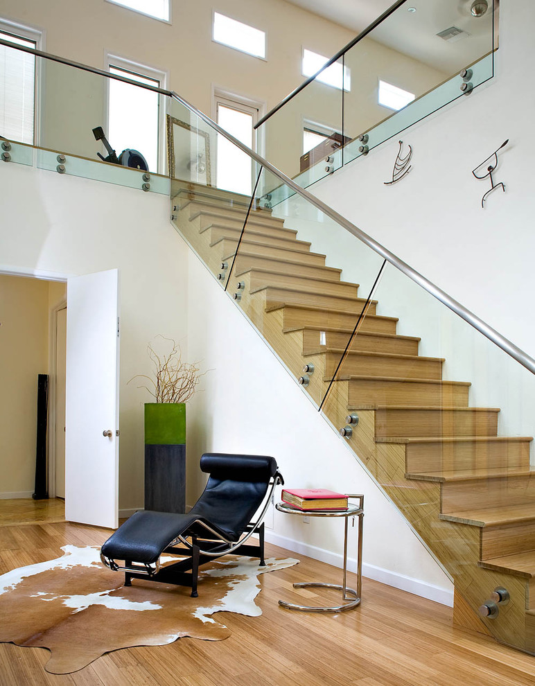 Inspiration for a contemporary glass railing staircase remodel in Los Angeles