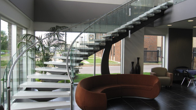 Granite Treads With Curved Railings And Glass Panels