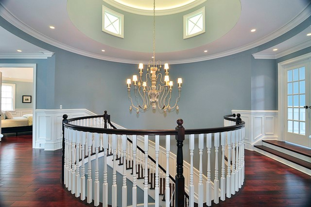 The Curvaceous Main Staircase Leads To An Open Airy Rotunda On The