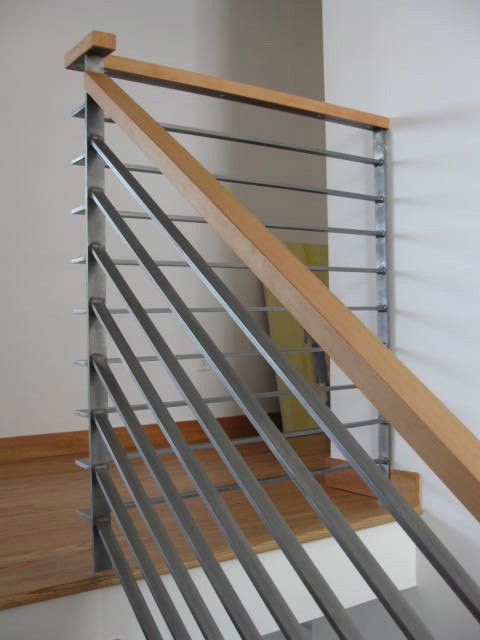 Inspiration For A Mid Sized Contemporary Wooden L Shaped Metal Railing Staircase Remodel In