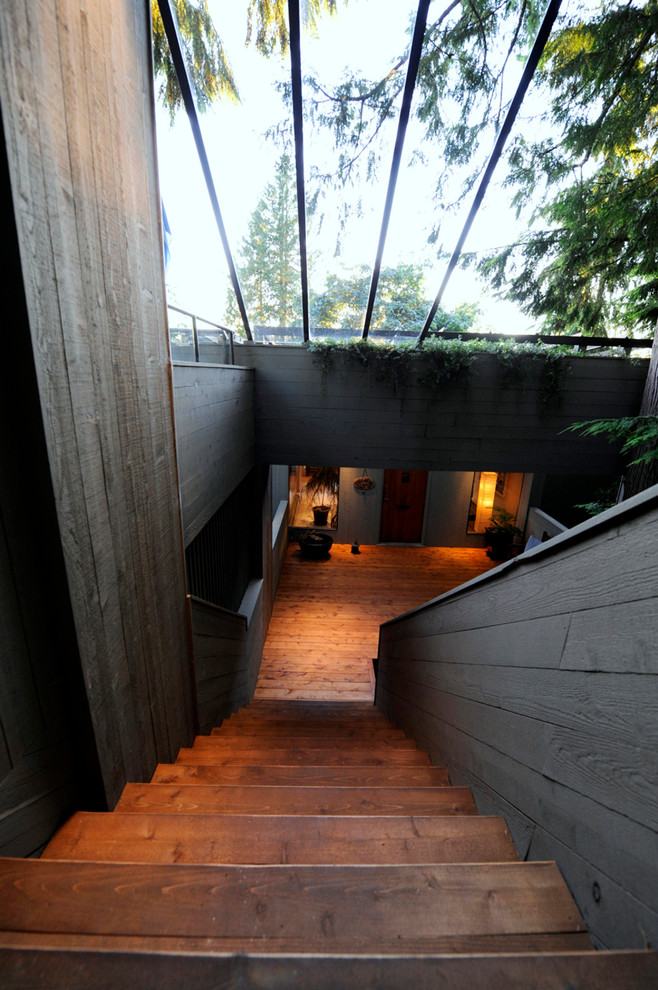Example of a large minimalist wooden straight wood railing staircase design in Vancouver with wooden risers