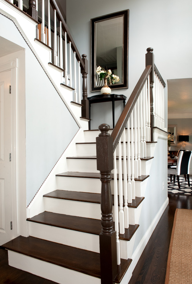 Elegant wooden u-shaped staircase photo in Boston