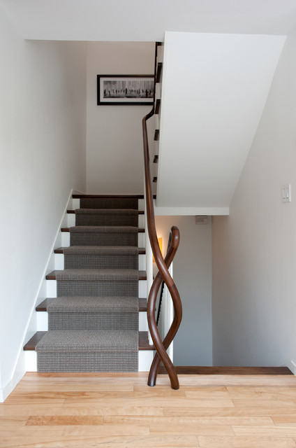Example of a trendy wooden staircase design in Burlington