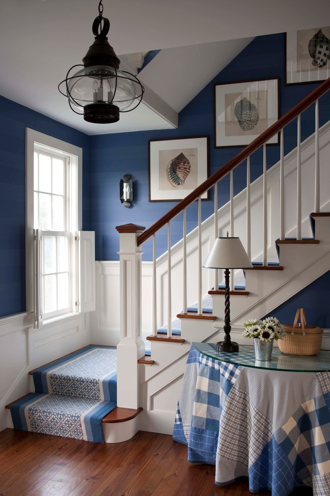 Inspiration for a mid-sized timeless wooden l-shaped staircase remodel in Boston with painted risers