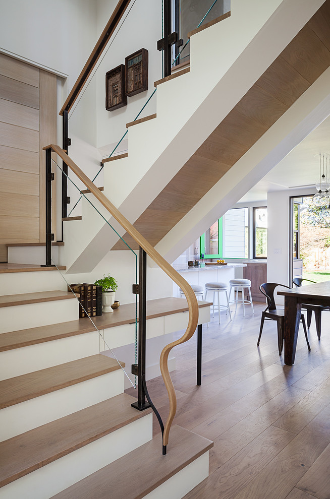 Example of a huge trendy wooden straight mixed material railing staircase design in San Francisco with painted risers