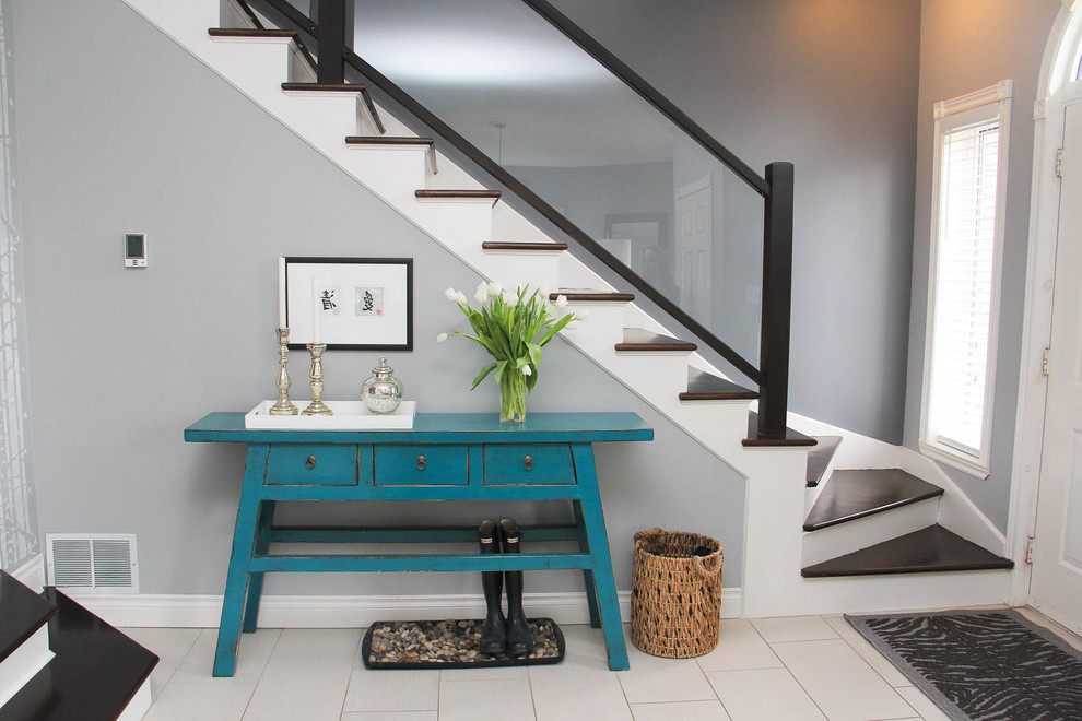 Inspiration for a transitional wooden staircase remodel in Other