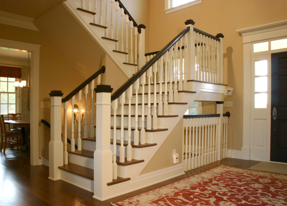 Inspiration for a timeless wooden staircase remodel in Columbus