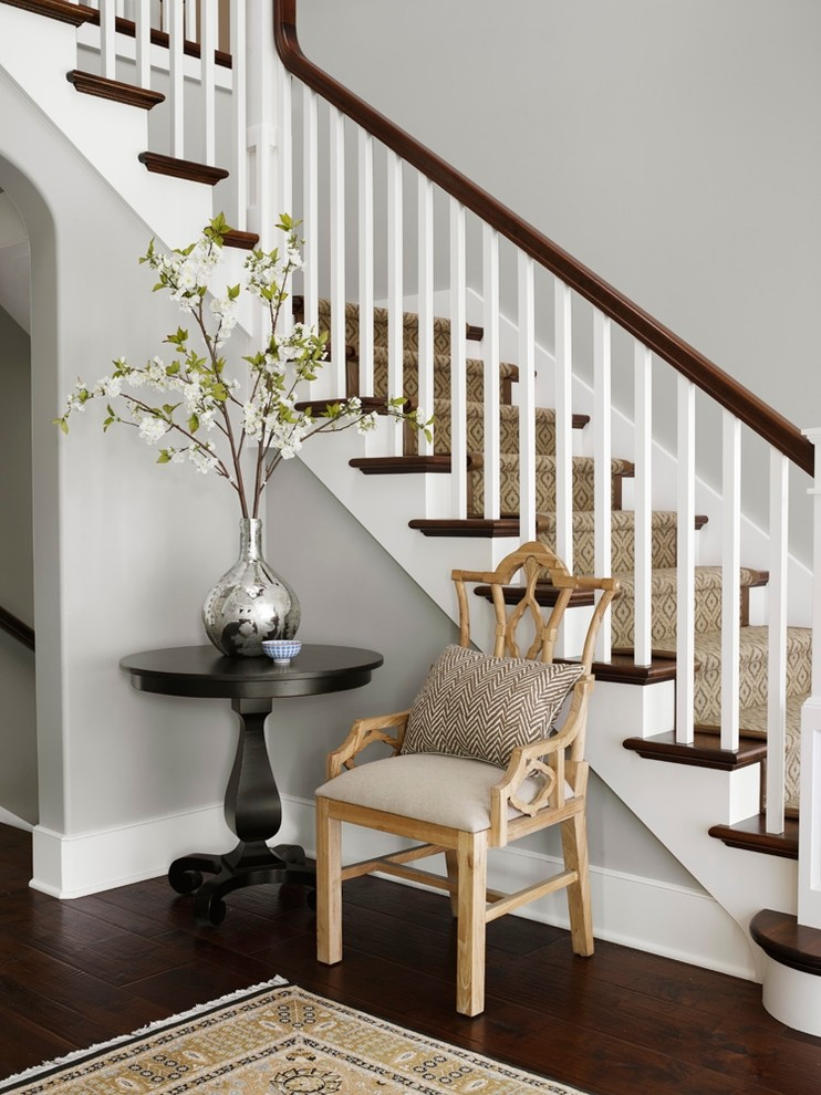 Staircase - traditional wooden l-shaped staircase idea in Chicago