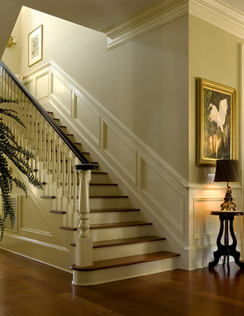 Nice moldings accentuate interior traditional-staircase