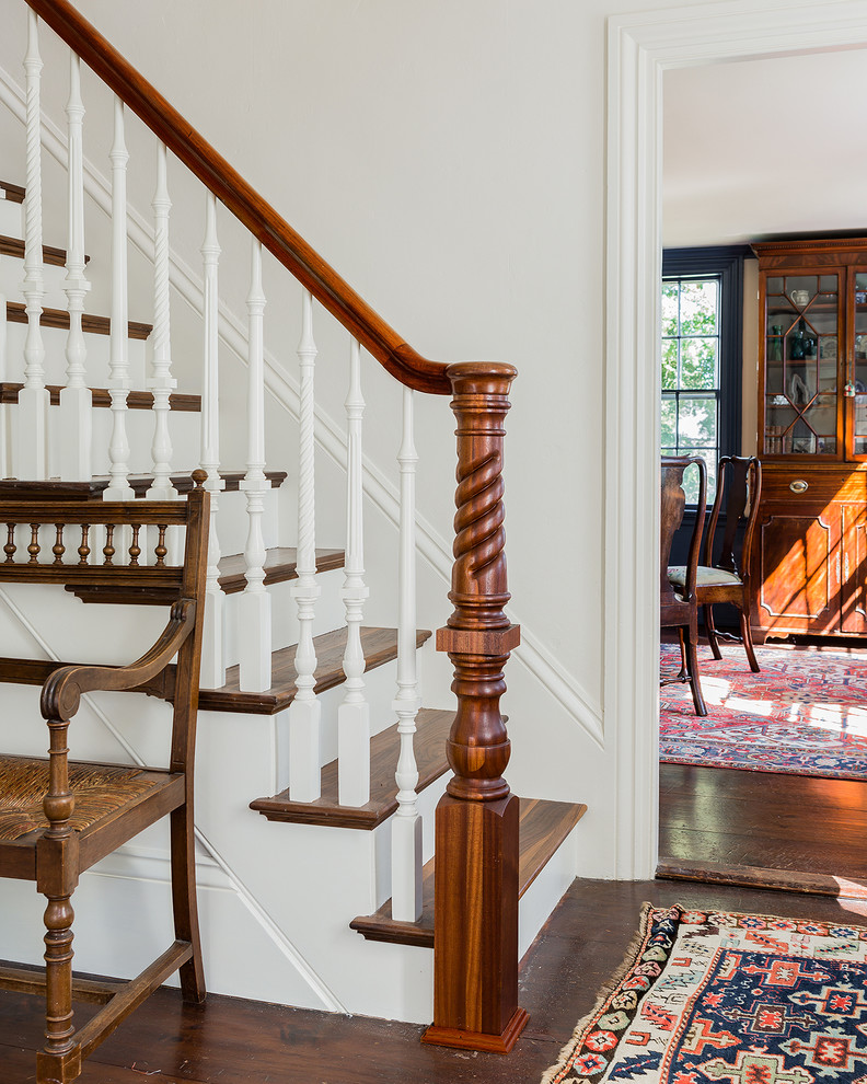 Staircase - traditional wooden straight staircase idea in Boston with painted risers