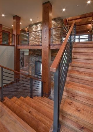 Northwest home: stairs with fireplace in entry contemporary-staircase