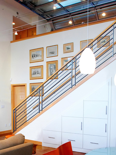 Stair to lower level with storage cabinets below for Stair cabinet design