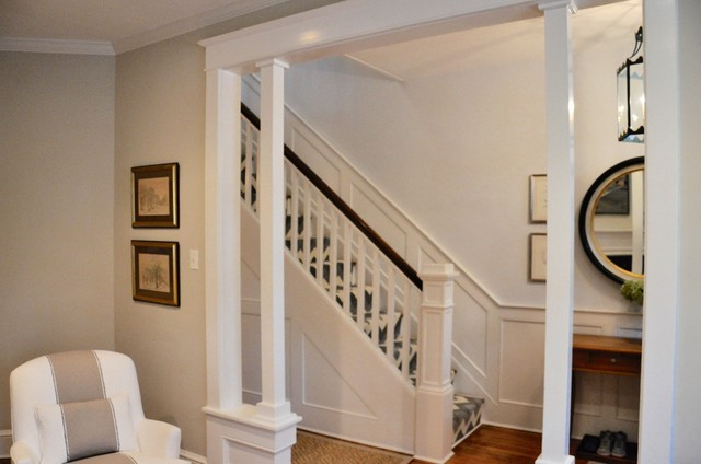 Example of a mid-sized classic wooden straight wood railing staircase design in DC Metro with painted risers