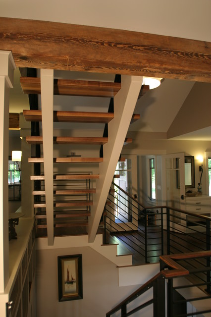 Open concept contemporary stairs with steal railing for Concept homes llc