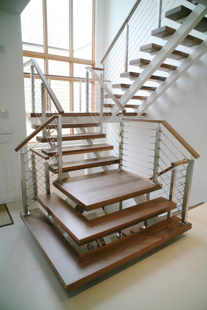 Example of a mid-sized minimalist wooden floating open staircase design in DC Metro