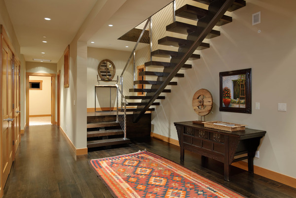 Open Riser Wood And Steel Stairs To Lower Level Bedrooms