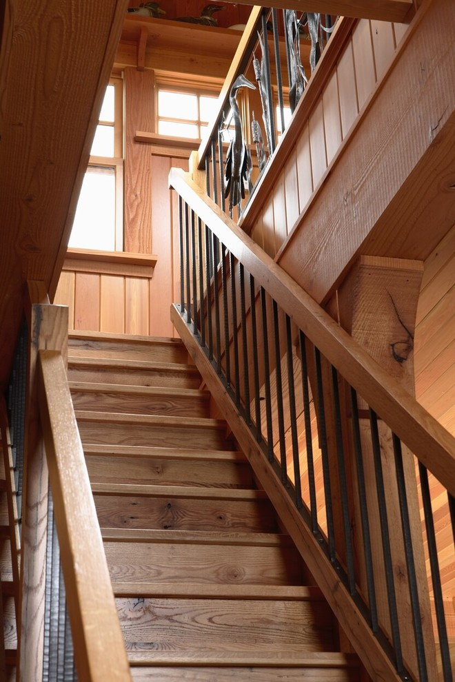 Staircase - rustic wooden mixed material railing staircase idea in Minneapolis with wooden risers