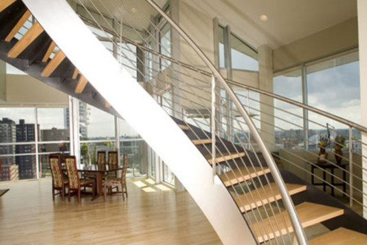 Inspiration for a mid-sized contemporary wooden curved staircase remodel in Cleveland with metal risers