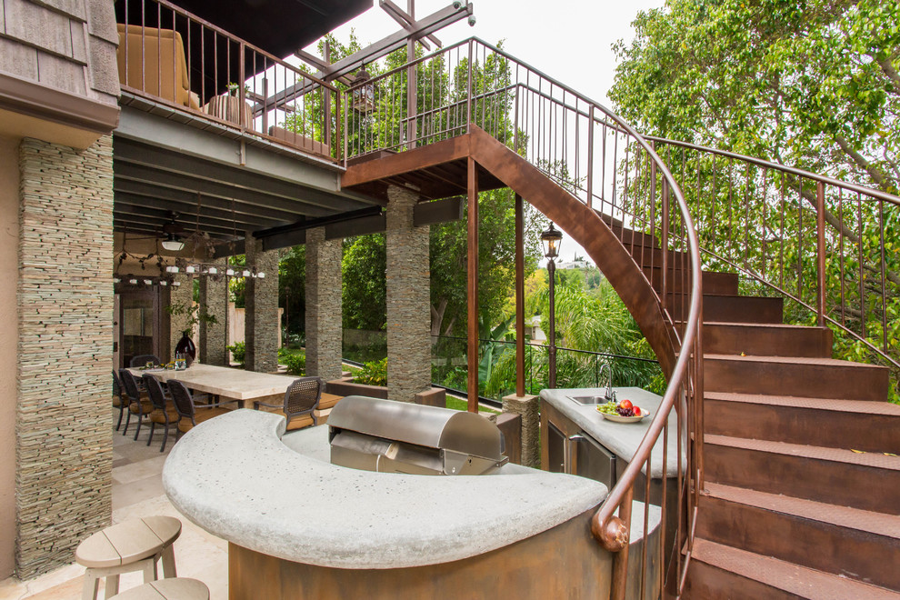 Staircase - large mediterranean metal curved staircase idea in Los Angeles with metal risers