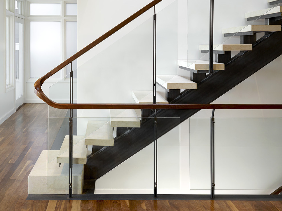 Urban limestone straight glass railing and open staircase photo in San Francisco