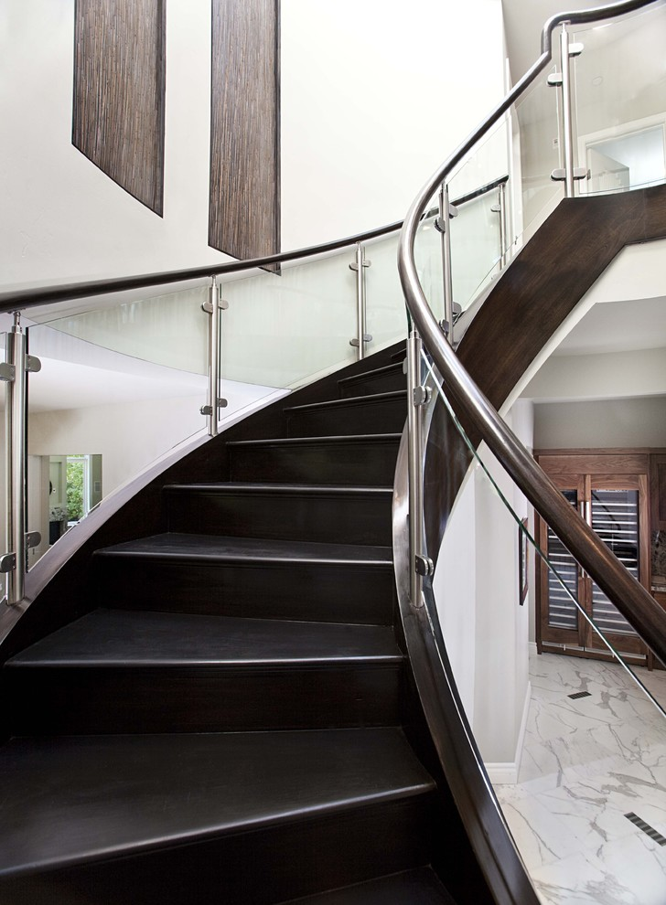 Trendy wooden curved staircase photo in San Francisco with wooden risers