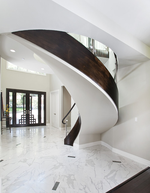 Curved two-stringer staircase with exposed soffit
