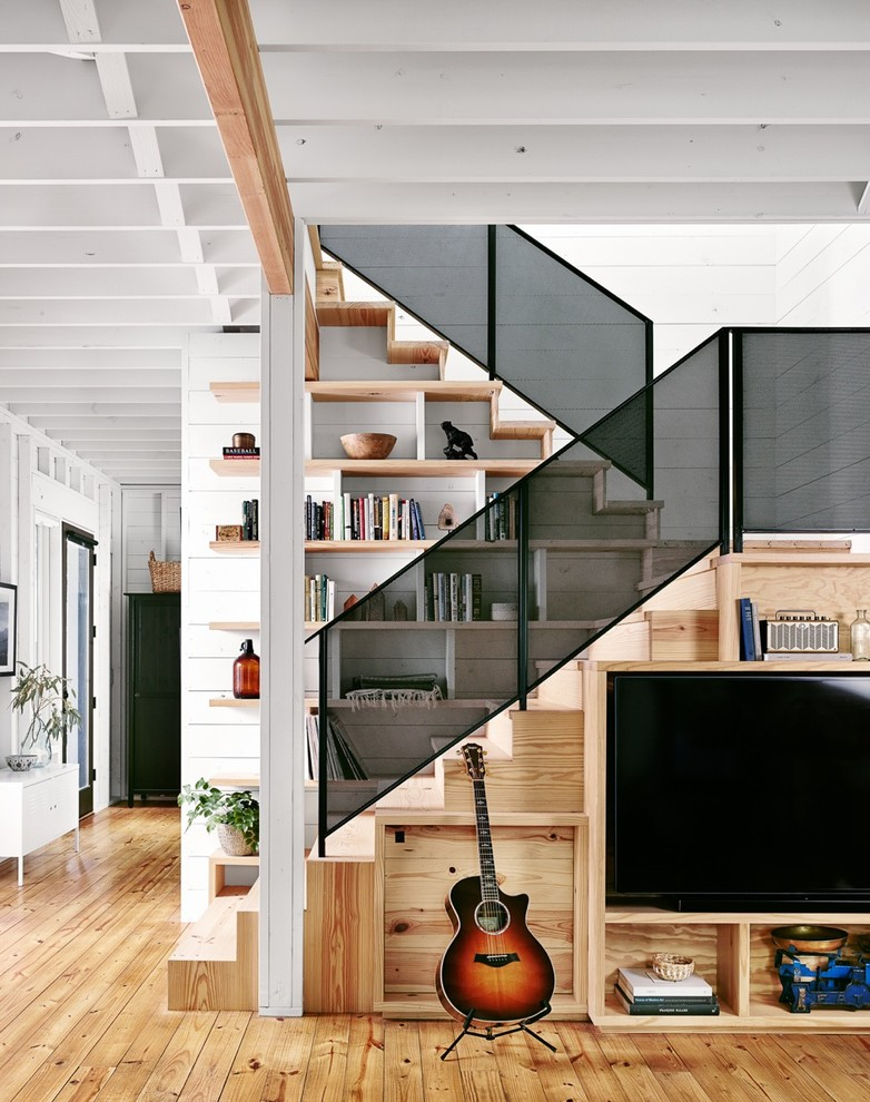 Inspiration for a mid-sized cottage wooden u-shaped staircase remodel in Austin with wooden risers