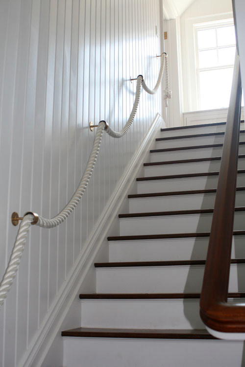 coastal style staircase rope handrail