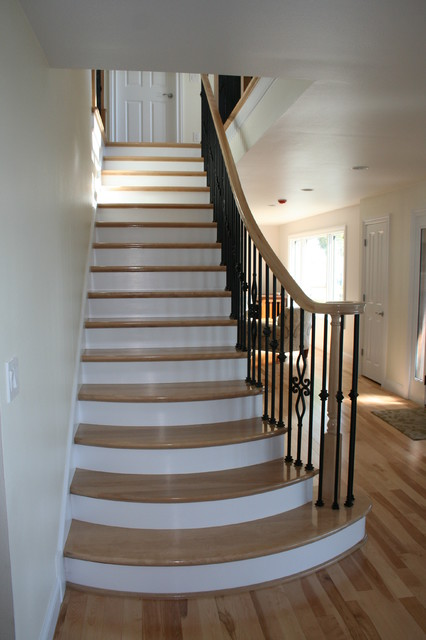 Radius Flared Stair Project/ Simon-Ware Residence traditional-staircase