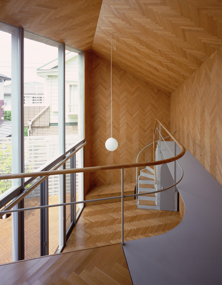 Inspiration for a small contemporary wooden curved staircase remodel in Other