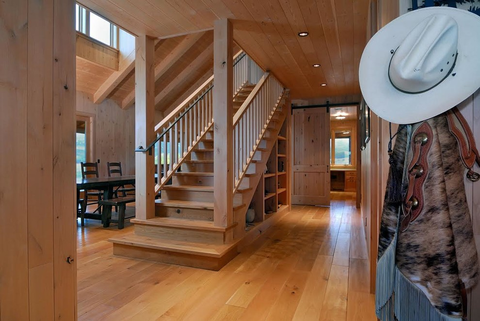Staircase - rustic wooden straight wood railing staircase idea in San Francisco