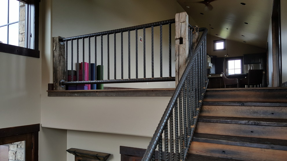 Large urban wooden l-shaped metal railing staircase photo in Other with wooden risers