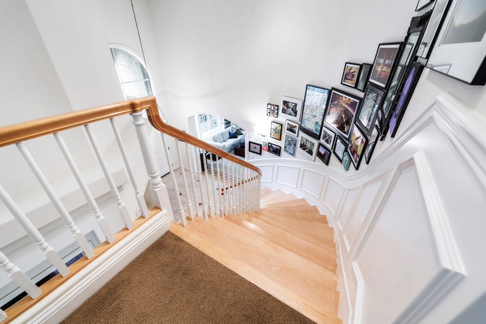 Example of a classic wooden curved staircase design in San Francisco