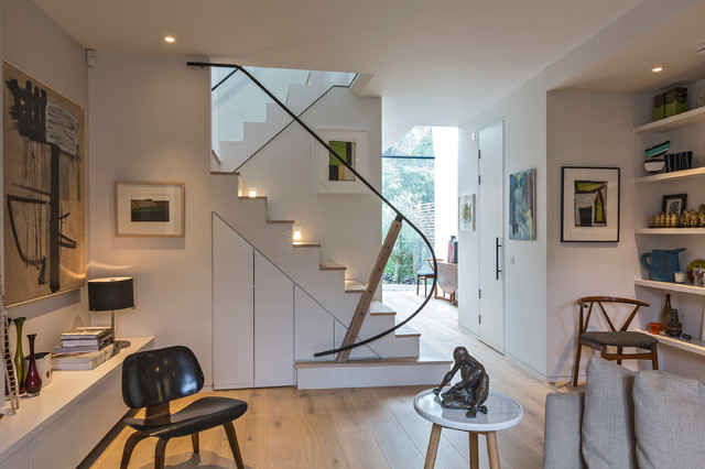 Staircase - contemporary wooden u-shaped staircase idea in London